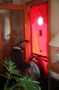 Eric performing a blower door during a home energy audit for a client