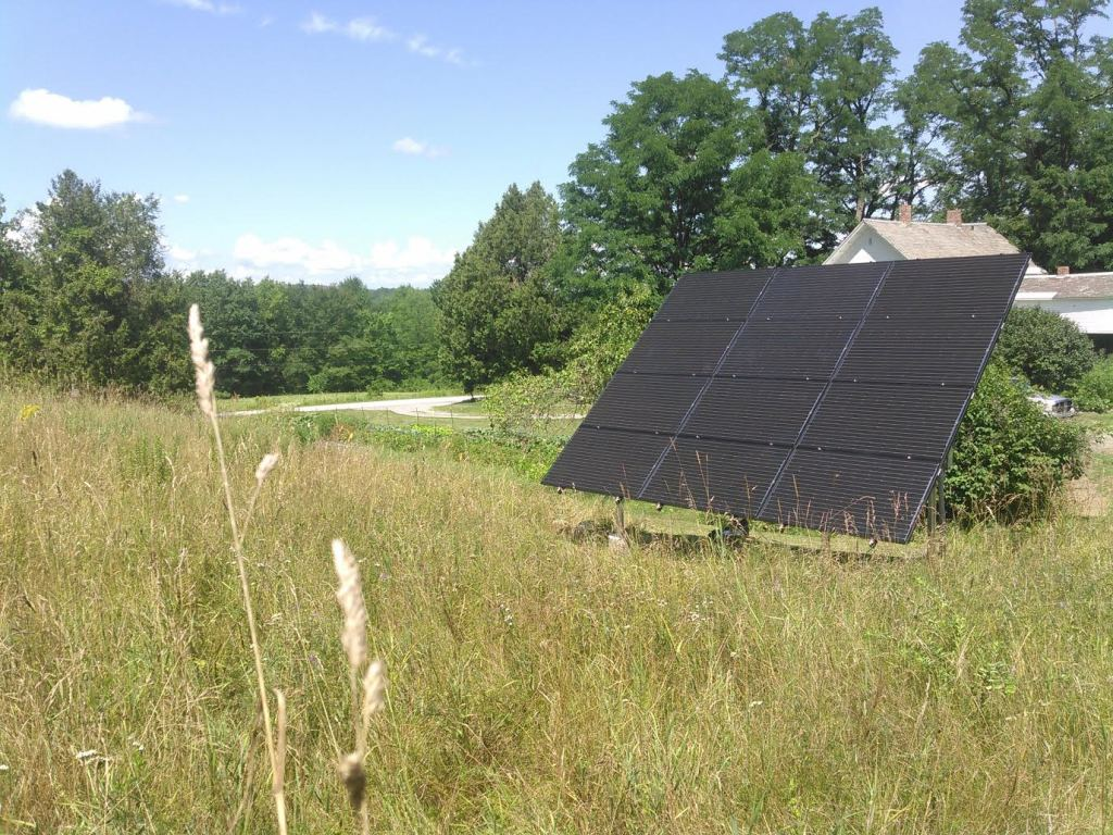 12 Solar panels installed on the ground are producing enough electricity to power this entire home all year round!